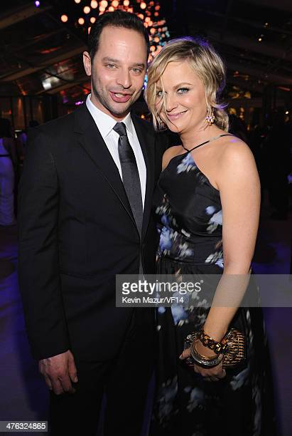 Nick Kroll and Amy Poehler attend the 2014 Vanity Fair Oscar Party Hosted By Graydon Carter on March 2 2014 in West Hollywood California