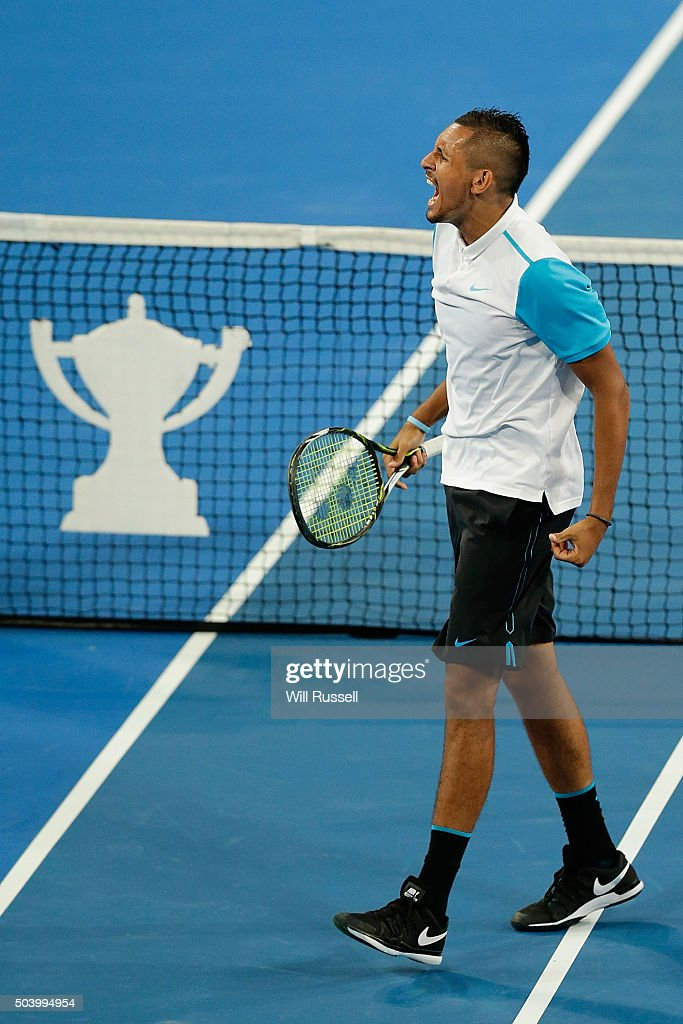 Nick Krygios of Australia Green celebrates after defeating Carline Garcia and Kenny De Schepper of France in the mixed doubles match during day six of the 2016 Hopman Cup at Perth Arena on January 8, 2016 in Perth, Australia.