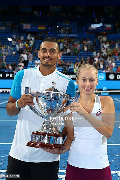 Nick Kyrgios and Daria Gavrilova of Australia Green pose with the Hopman Cup after winning the final against Elina Svitolina and Alexandr Dolgopolov...