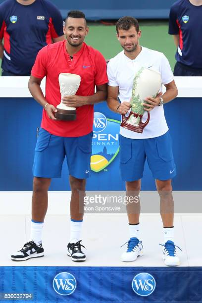 Nick Kyrgios and Grigor Dimitrov pose with their trophies after their championship match at the Western Southern Open at the Lindner Family Tennis...