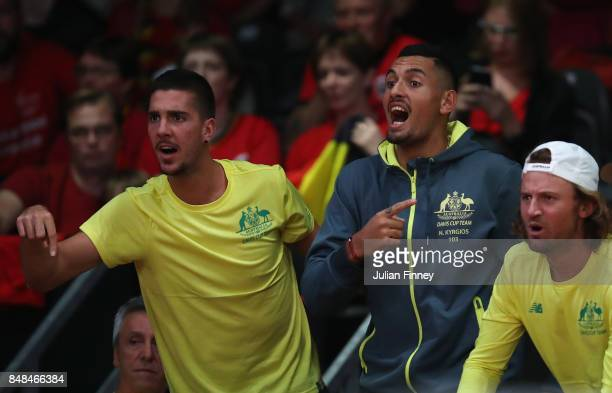 Nick Kyrgios and Thanasi Kokkinakis of Australia support Jordan Thompson of Australia in his match against Steve Darcis of Belgium during day three...
