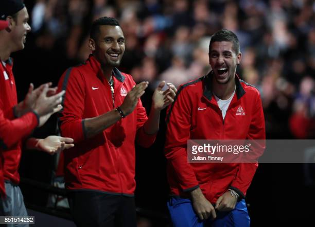 Nick Kyrgios and Thanasi Kokkinakis of Team World react on the players bench as John Isner of Team World plays his singles match against Dominic...