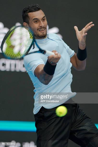 Nick Kyrgios of Aurstralia hits a return during his men's singles match against Mischa Zverev of Germany at the China Open tennis tournament in...