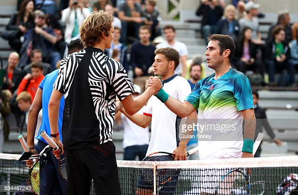 Nick Kyrgios of Australia and Alexander Zverev of Germany shake hands with Pablo Carreno Busta and David Marrero of Spain following their victory...