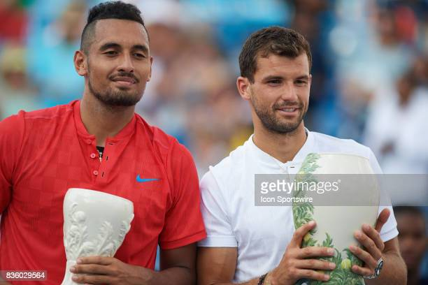 Nick Kyrgios of Australia and Grigor Dimitrov of Bulgaria pose with their trophies after the men's finals in the Western Southern Open at the Lindner...