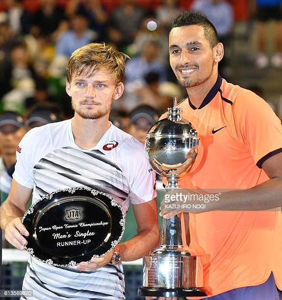 Nick Kyrgios of Australia and runnerup Belgium's David Goffin pose during the awards ceremony after the men's singles final at the ATP Japan Open...