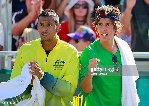 Nick Kyrgios of Australia and Thanasi Kokkinakis of Australia show their support during the reverse singles match between Lleyton Hewitt of Australia...