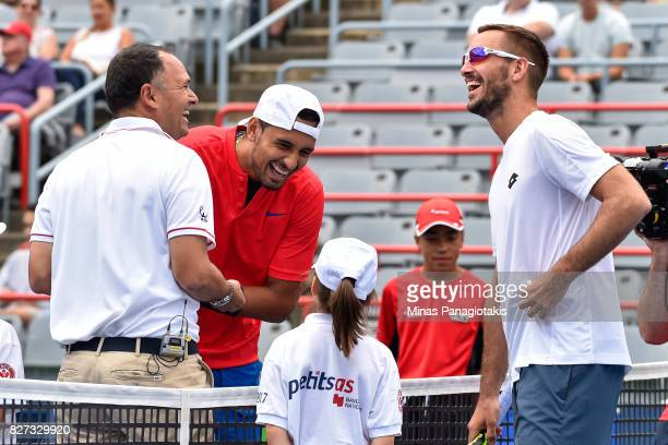 Nick Kyrgios of Australia and Viktor Troicki of Serbia Montenegro have a laugh with chair umpire Mohamed Lahyani of Sweden during day four of the...