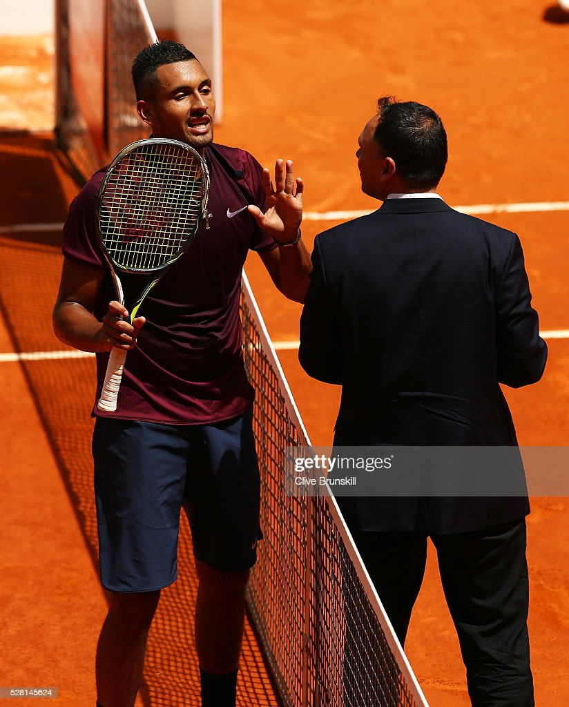 <a gi-track='captionPersonalityLinkClicked' href=/galleries/search?phrase=Nick+Kyrgios&family=editorial&specificpeople=6705178 ng-click='$event.stopPropagation()'>Nick Kyrgios</a> of Australia argues with match umpire <a gi-track='captionPersonalityLinkClicked' href=/galleries/search?phrase=Mohamed+Lahyani&family=editorial&specificpeople=824130 ng-click='$event.stopPropagation()'>Mohamed Lahyani</a> during his straight sets victory against Stanislas Wawrinka of Switzerland in their second round match during day five of the Mutua Madrid Open tennis tournament at the Caja Magica on May 04, 2016 in Madrid.