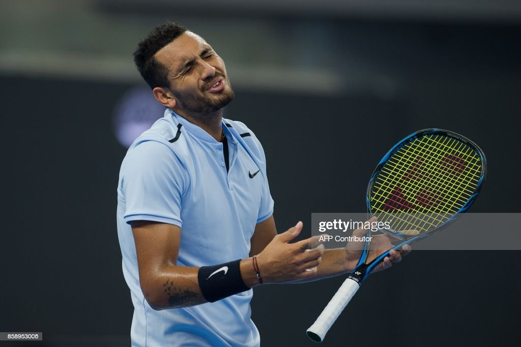 Nick Kyrgios of Australia argues with the referee during his men's singles final match against Rafael Nadal of Spain at the China Open tennis tournament in Beijing on October 8, 2017. /