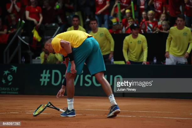 Nick Kyrgios of Australia breaks his racket in the match against David Goffin of Belgium during day three of the Davis Cup World Group semi final...