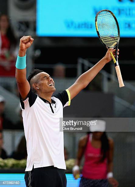Nick Kyrgios of Australia celebrates match point against Roger Federer of Switzerland in their second round match during day five of the Mutua Madrid...