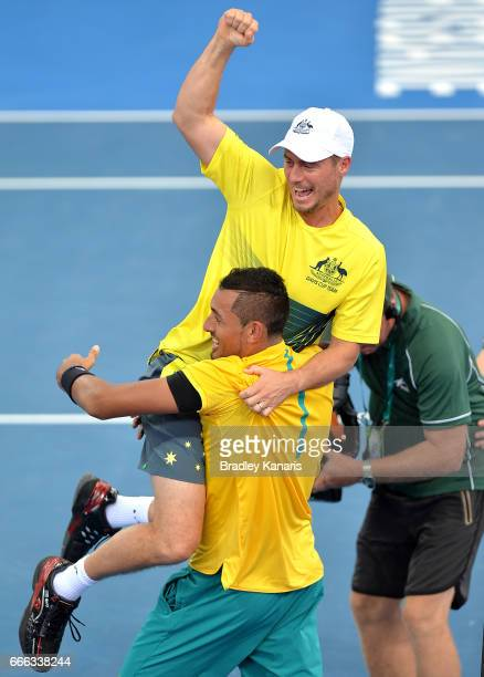 Nick Kyrgios of Australia celebrates victory with Team Captain Lleyton Hewitt after his match against Sam Querrey of the USA during the Davis Cup...