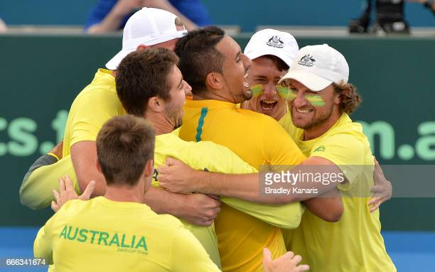 Nick Kyrgios of Australia celebrates victory with team mates after his match against Sam Querrey of the USA during the Davis Cup World Group...