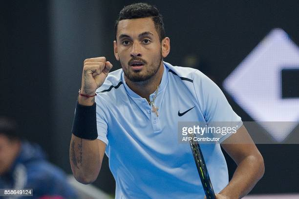 Nick Kyrgios of Australia celebrates winning a point during his men's singles semifinal match against Alexander Zverev of Germany at the China Open...