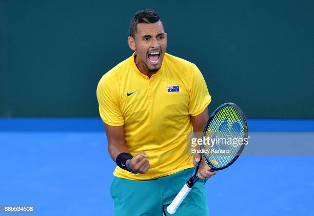 Nick Kyrgios of Australia celebrates winning a point in his match against John Isner of the USA during the Davis Cup World Group Quarterfinals...