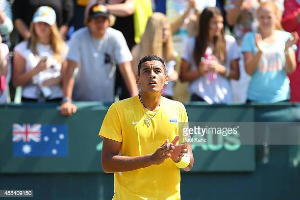 Nick Kyrgios of Australia celebrates winning his reverse singles match against Sanjar Fayziev of Uzbekistan during the Davis Cup World Group Playoff...