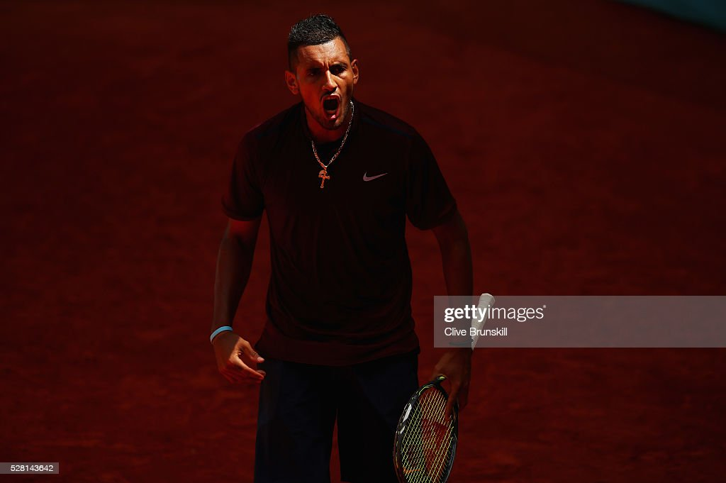 <a gi-track='captionPersonalityLinkClicked' href=/galleries/search?phrase=Nick+Kyrgios&family=editorial&specificpeople=6705178 ng-click='$event.stopPropagation()'>Nick Kyrgios</a> of Australia celebrates winning the first set during his straight sets victory against Stanislas Wawrinka of Switzerland in their second round match during day five of the Mutua Madrid Open tennis tournament at the Caja Magica on May 04, 2016 in Madrid.