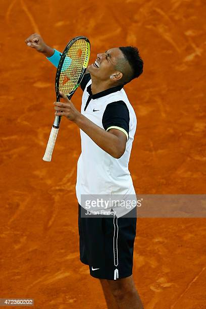 Nick Kyrgios of Australia celerates defeating Roger Federer of Switzerland during day five of the Mutua Madrid Open tennis tournament at the Caja...