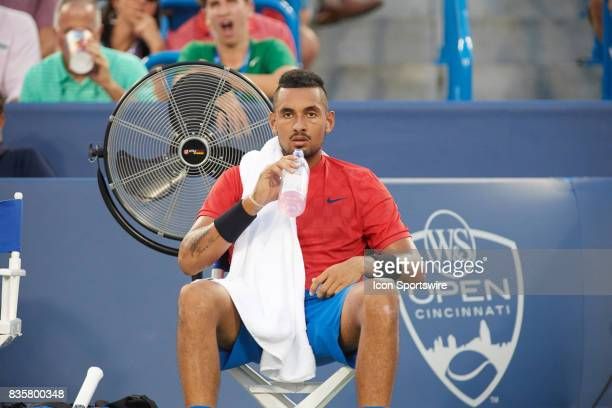 Nick Kyrgios of Australia concentrates on a changeover break against David Ferrer of Spain during their semifinal match in the Western Southern Open...