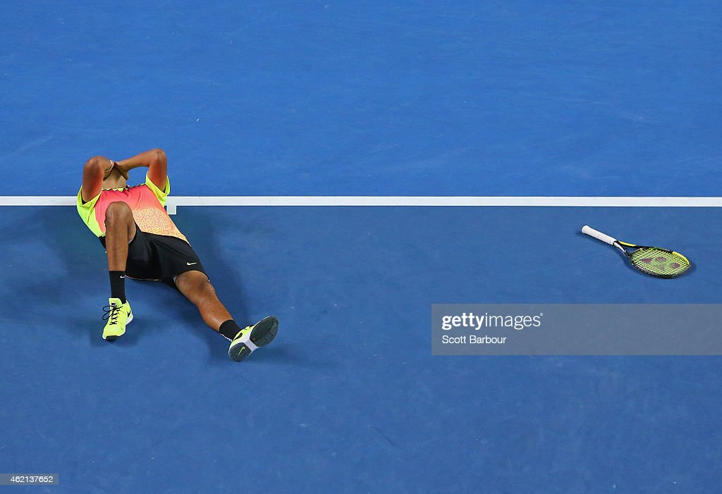 Nick Kyrgios of Australia falls to the ground as he celebrates winning his fourth round match against Andreas Seppi of Italy during day seven of the 2015 Australian Open at Melbourne Park on January 25, 2015 in Melbourne, Australia.