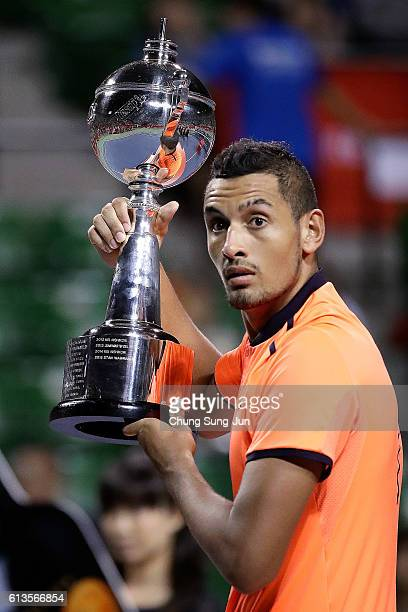 Nick Kyrgios of Australia gets surprised at the confetti cannon after winning the men's singles final match against David Goffin of Belgium on day...