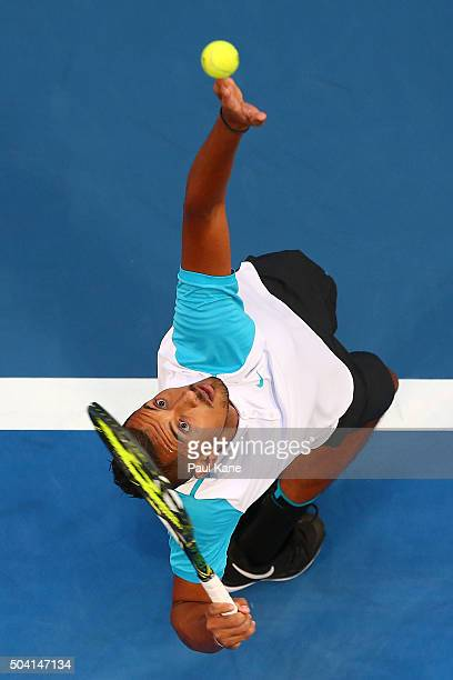 Nick Kyrgios of Australia Green serves to Alexandr Dolgopolov of the Ukraine in the men's singles final during day seven of the 2016 Hopman Cup at...