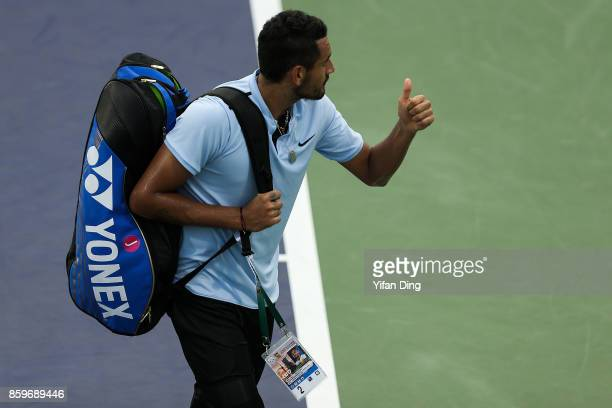 Nick Kyrgios of Australia greets the audience after retiring from the Men's singles mach against Steve Johnson of United States on day 3 of Shanghai...