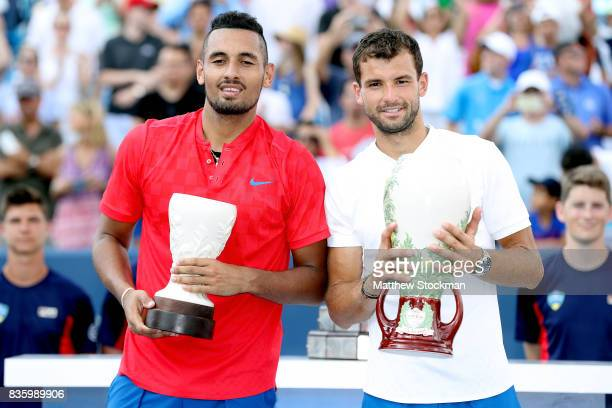 Nick Kyrgios of Australia Grigor Dimitrov of Bulgaria poses for photographers at the trophy ceremony during the men's final on day 9 of the Western...