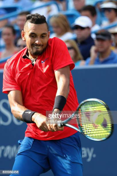 Nick Kyrgios of Australia Grigor returns a shot to Dimitrov of Bulgaria during the men's final during Day 9 of of the Western and Southern Open at...