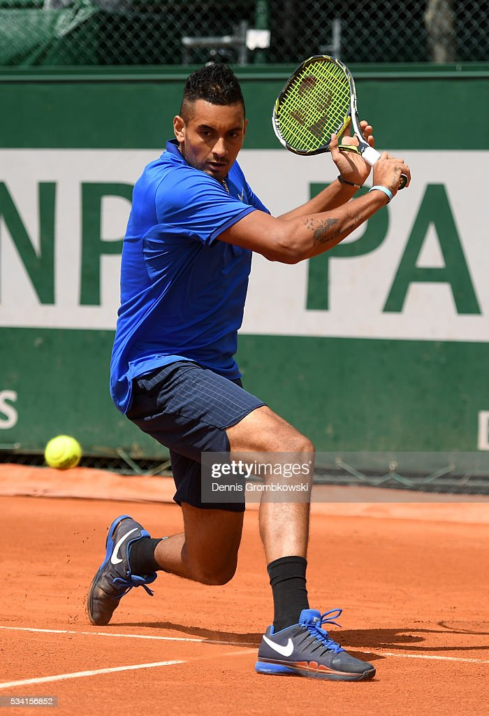 <a gi-track='captionPersonalityLinkClicked' href=/galleries/search?phrase=Nick+Kyrgios&family=editorial&specificpeople=6705178 ng-click='$event.stopPropagation()'>Nick Kyrgios</a> of Australia hits a backhand during the Men's Singles second round match against Igor Sijsling of Netherlands on day four of the 2016 French Open at Roland Garros on May 25, 2016 in Paris, France.