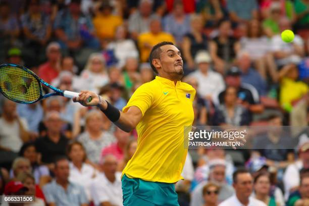 Nick Kyrgios of Australia hits a return against Sam Querrey of the US during their tennis match in the world group quarterfinal Davis Cup clash...