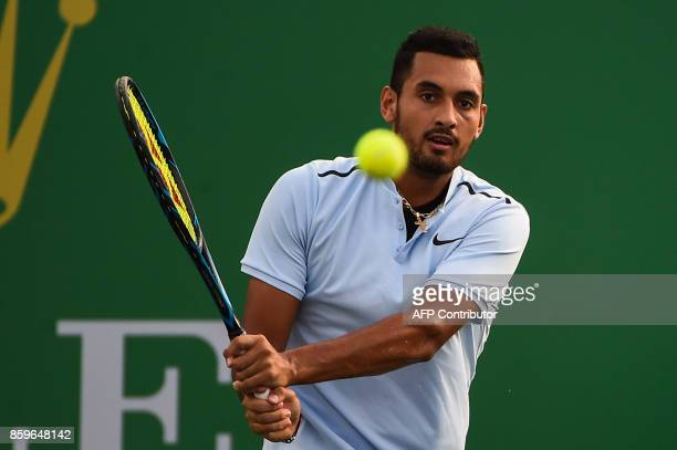 Nick Kyrgios of Australia hits a return during the men's singles against Steve Johnson of America at the Shanghai Masters tennis tournament in...