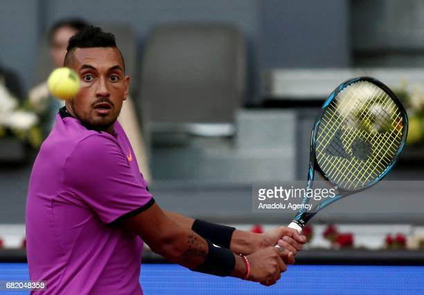 Nick Kyrgios of Australia in action against Rafael Nadal of Spain during the ATP Masters 1000 Open men's tennis match within the Mutua Madrid Open at...
