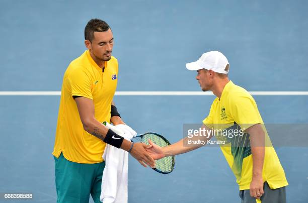Nick Kyrgios of Australia is encouraged by Team Captain Lleyton Hewitt in his match against Sam Querrey of the USA during the Davis Cup World Group...