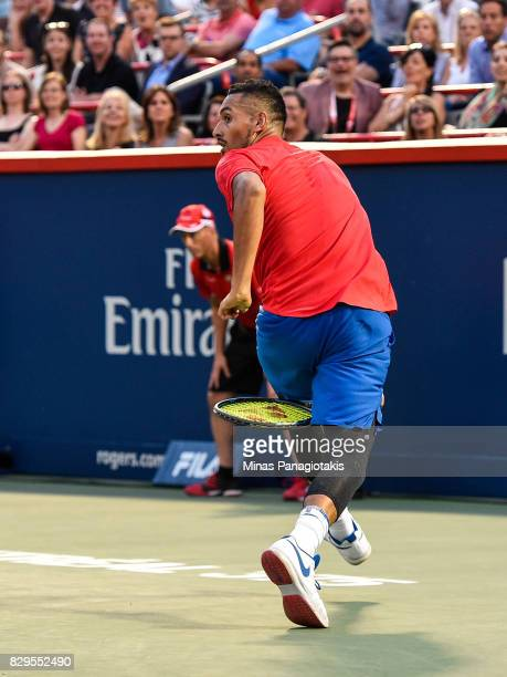 Nick Kyrgios of Australia looks behind him after hitting the ball through his legs against Alexander Zverev of Germany during day seven of the Rogers...