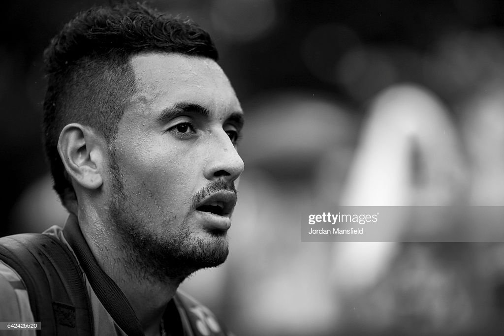 Nick Kyrgios of Australia looks on as he walks off court as rain delays his match with Juan Monaco of Argentina during day three of The Boodles Tennis Event at Stoke Park on June 21, 2016 in Stoke Poges, England.