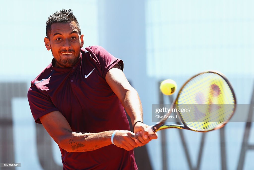 <a gi-track='captionPersonalityLinkClicked' href=/galleries/search?phrase=Nick+Kyrgios&family=editorial&specificpeople=6705178 ng-click='$event.stopPropagation()'>Nick Kyrgios</a> of Australia plays a backhand against Guido Pella of Argentina in their first round match during day four of the Mutua Madrid Open tennis tournament at the Caja Magica on May 03, 2016 in Madrid,Spain.