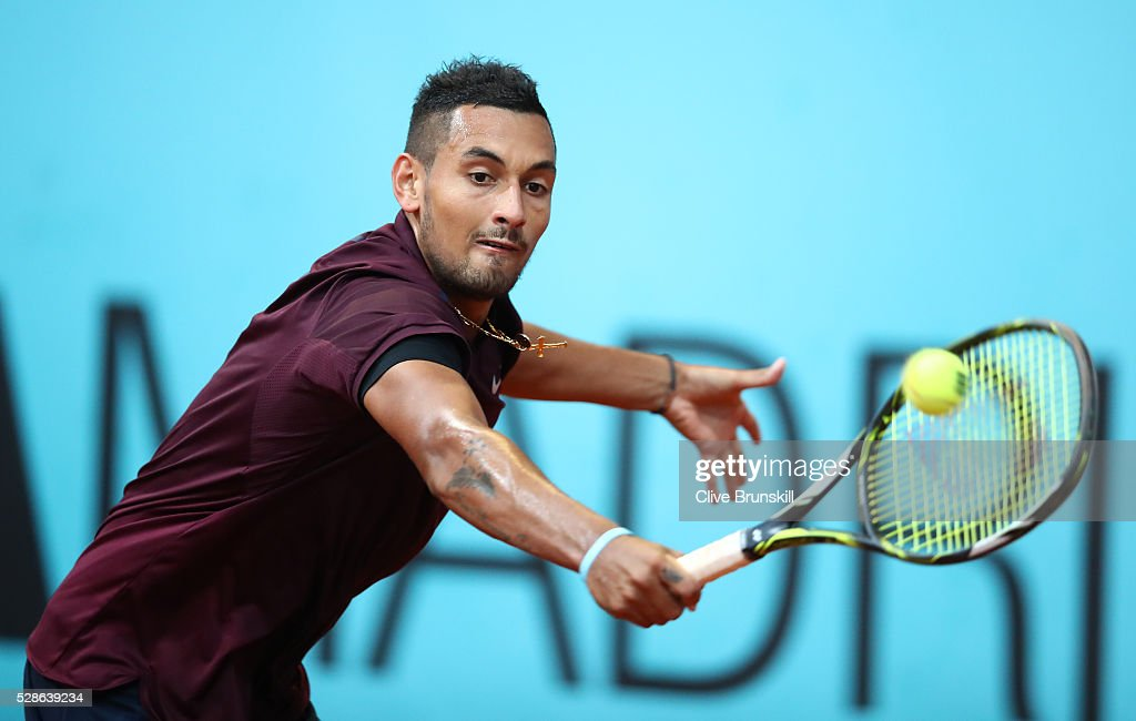 Nick Kyrgios of Australia plays a backhand against Kei Nishikori of Japan in their quarter final round match during day seven of the Mutua Madrid Open tennis tournament at the Caja Magica on May 06, 2016 in Madrid,Spain.