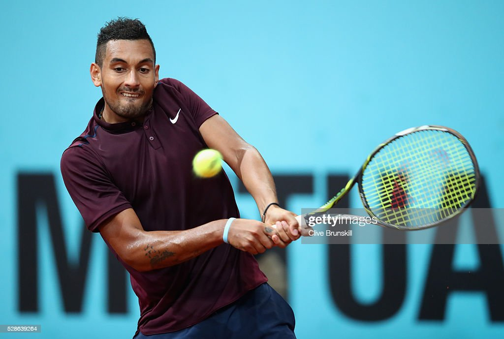 <a gi-track='captionPersonalityLinkClicked' href=/galleries/search?phrase=Nick+Kyrgios&family=editorial&specificpeople=6705178 ng-click='$event.stopPropagation()'>Nick Kyrgios</a> of Australia plays a backhand against Kei Nishikori of Japan in their quarter final round match during day seven of the Mutua Madrid Open tennis tournament at the Caja Magica on May 06, 2016 in Madrid,Spain.