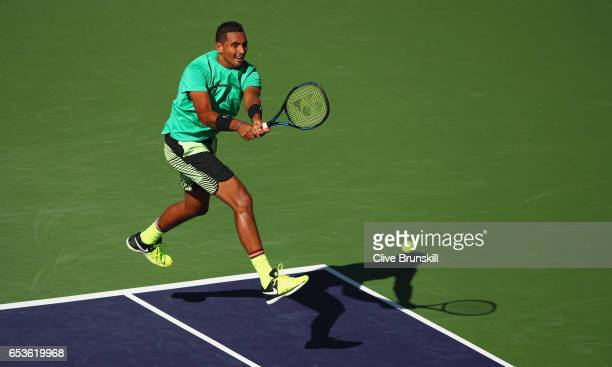 Nick Kyrgios of Australia plays a backhand during his straight set victory against Novak Djokovic of Serbia in their fourth round match during day...
