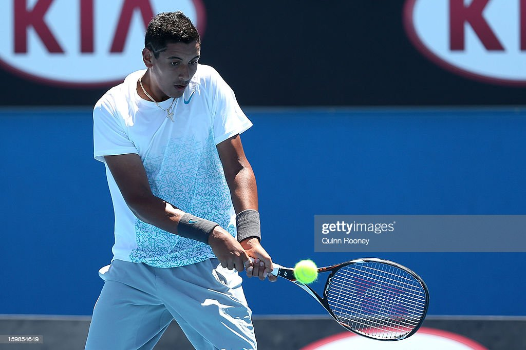 Nick Kyrgios of Australia plays a backhand in his second round match against Cameron Norrie of New Zealand during the 2013 Australian Open Junior Championshipsat Melbourne Park on January 22, 2013 in Melbourne, Australia.