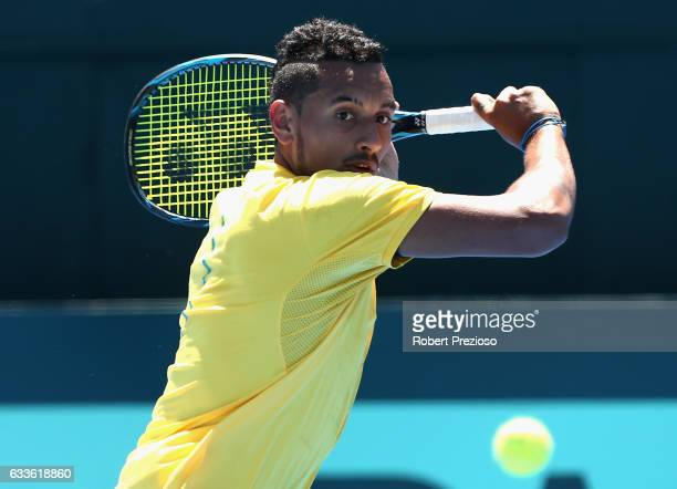 Nick Kyrgios of Australia plays a backhand in his singles match against Jan Satral of Czech Republic during the first round World Group Davis Cup tie...