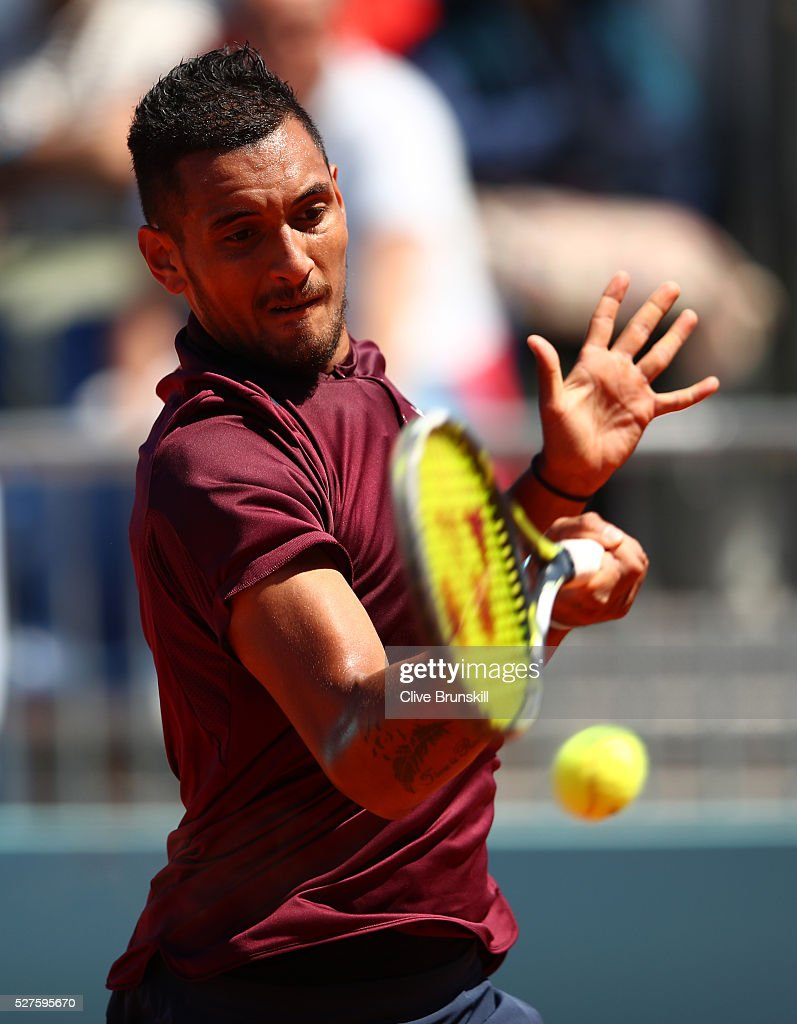<a gi-track='captionPersonalityLinkClicked' href=/galleries/search?phrase=Nick+Kyrgios&family=editorial&specificpeople=6705178 ng-click='$event.stopPropagation()'>Nick Kyrgios</a> of Australia plays a forehand against Guido Pella of Argentina in their first round match during day four of the Mutua Madrid Open tennis tournament at the Caja Magica on May 03, 2016 in Madrid,Spain.