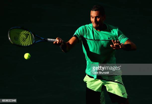 Nick Kyrgios of Australia plays a forehand during his straight set victory against Novak Djokovic of Serbia in their fourth round match during day...