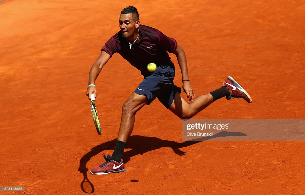<a gi-track='captionPersonalityLinkClicked' href=/galleries/search?phrase=Nick+Kyrgios&family=editorial&specificpeople=6705178 ng-click='$event.stopPropagation()'>Nick Kyrgios</a> of Australia plays a forehand during his straight sets victory against Stanislas Wawrinka of Switzerland in their second round match during day five of the Mutua Madrid Open tennis tournament at the Caja Magica on May 04, 2016 in Madrid.