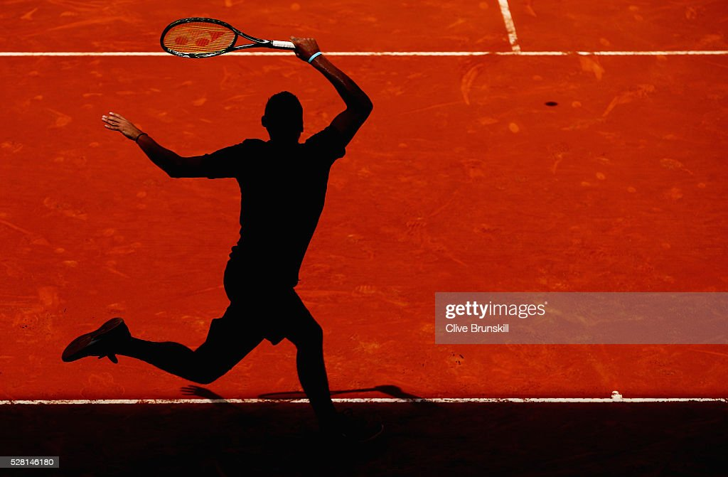 Nick Kyrgios of Australia plays a forehand during his straight sets victory against Stanislas Wawrinka of Switzerland in their second round match during day five of the Mutua Madrid Open tennis tournament at the Caja Magica on May 04, 2016 in Madrid.