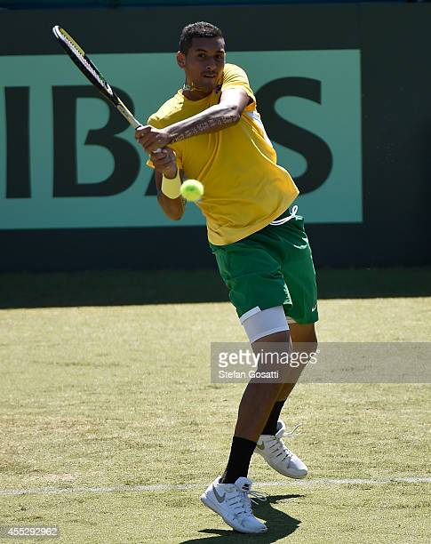 Nick Kyrgios of Australia plays a return shot to Denis Istomin of Uzbekistan in their singles match during the Davis Cup World Group Playoff tie at...