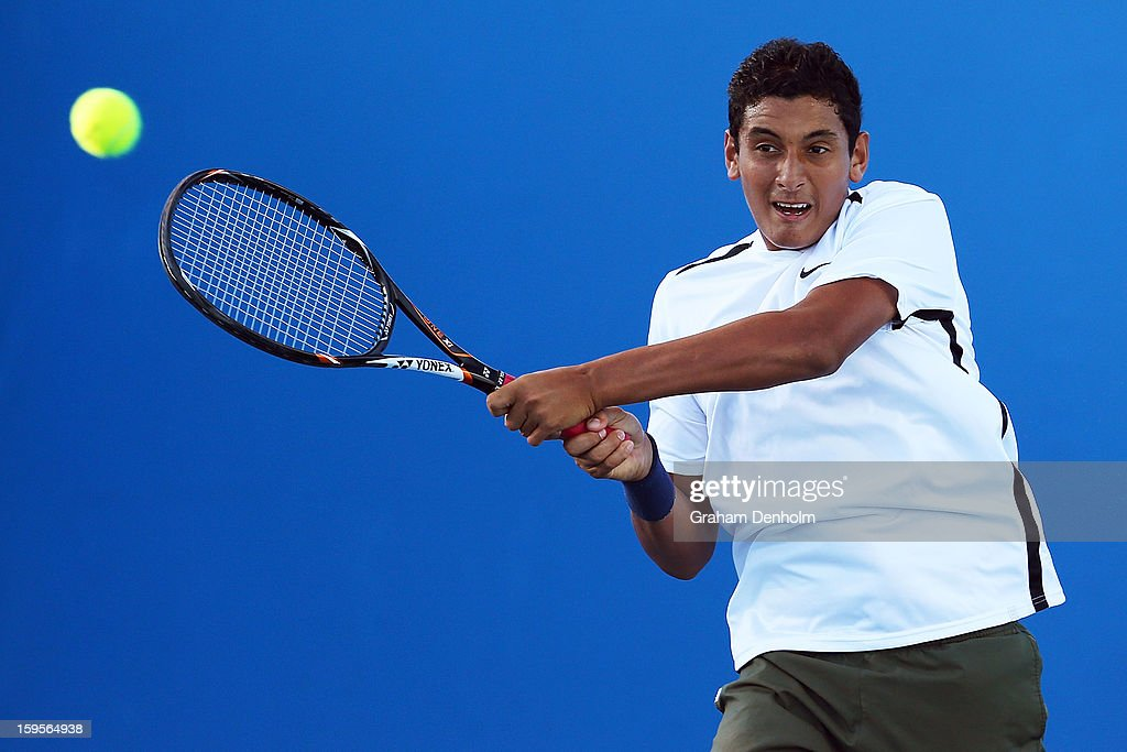 Nick Kyrgios of Australia plays a shot in his first round doubles match with Thanasi Kokkinakis of Australia against Rohan Bopanna of India and Rajeev Ram of India during day three of the 2013 Australian Open at Melbourne Park on January 16, 2013 in Melbourne, Australia.
