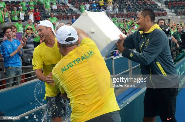 Nick Kyrgios of Australia pours a bucket of ice over Team Captain Lleyton Hewitt after their victory in the Davis Cup World Group Quarterfinals...